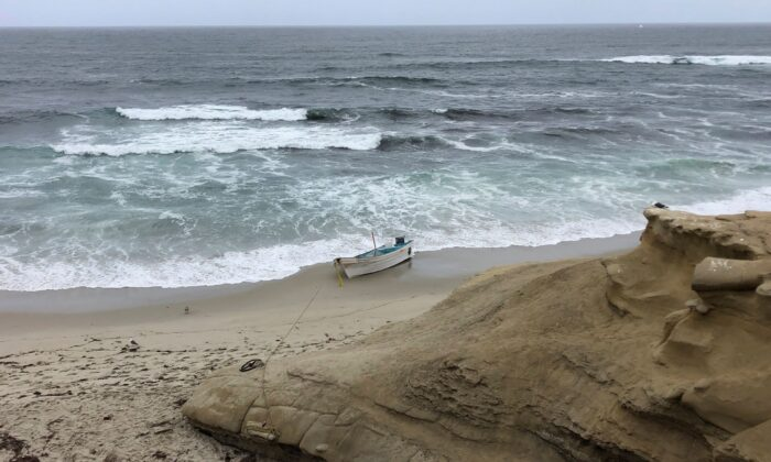 A small boat used during a suspected human smuggling operation sits on La Jolla beach in San Diego, Calif., on Thursday, May 20, 2021. (Gregory Bull/AP Photo)