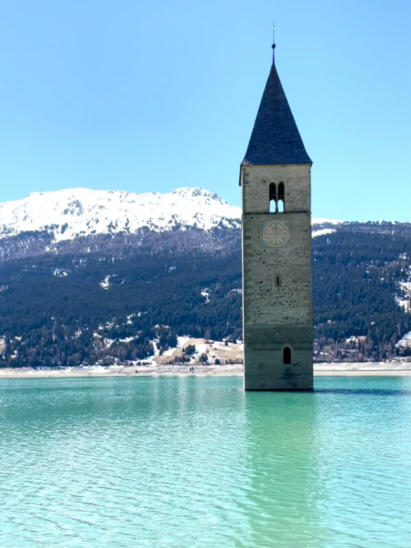 church bell tower emerging from a lake