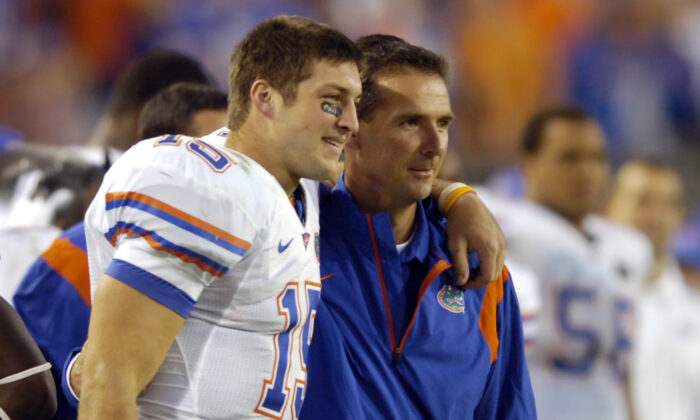 Florida quarterback Tim Tebow (L) and coach Urban Meyer celebrate in the fourth quarter during an NCAA college football game against Georgia in Jacksonville, Fla., on Nov. 1, 2008. (Stephen Morton/AP Photo)