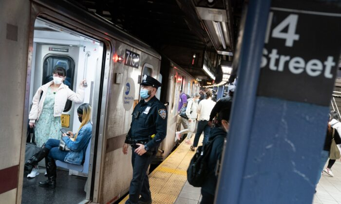 An NYPD officer checks a subway train as it pulls into Union Square subway station in Manhattan, New York City, on May 14, 2021. (Barry Williams/New York Daily News/TNS)