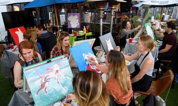Customers paint during a class in Huntington Beach, Calif., on May 19, 2021. (Patrick T. Fallon/AFP via Getty Images)