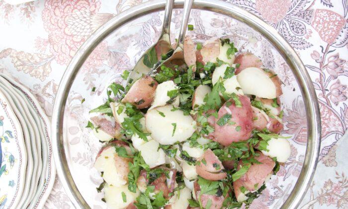 Fresh herbs enliven a simple potato salad. (Victoria de la Maza)