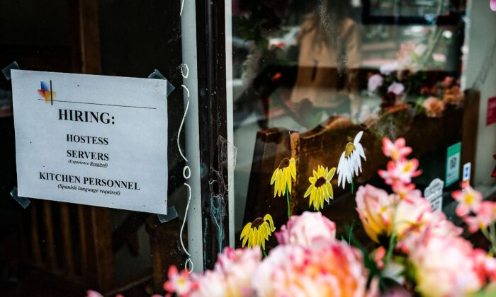 A restaurant advertises that they are hiring in Annapolis, Md., on May 12, 2021. (Jim Watson/AFP via Getty Images)