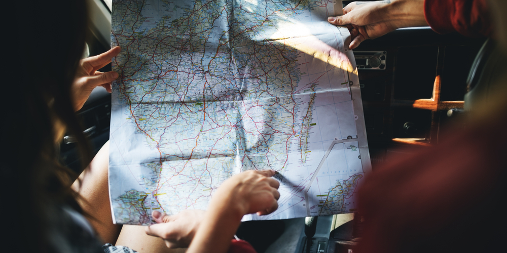 Friends,Reading,Map,Traveling,Destination,Camping,Concept