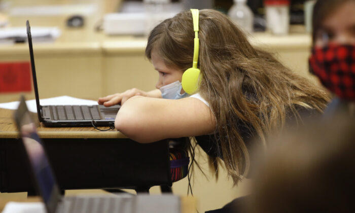 A student works on a computer at a Provo, Utah, school on Feb. 10, 2021. (George Frey/Getty Images)