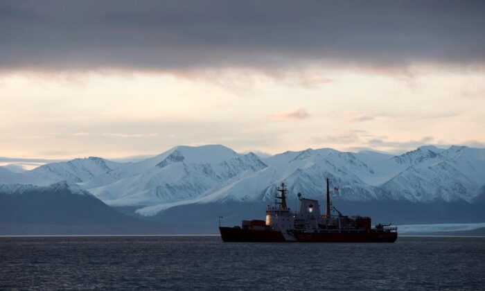 The Coast Guard ship Des Groseilliers sits at anchor off the hamlet of Pond Inlet, Nunavut on August 23, 2014. (Adrian Wyld/The Canadian Press)