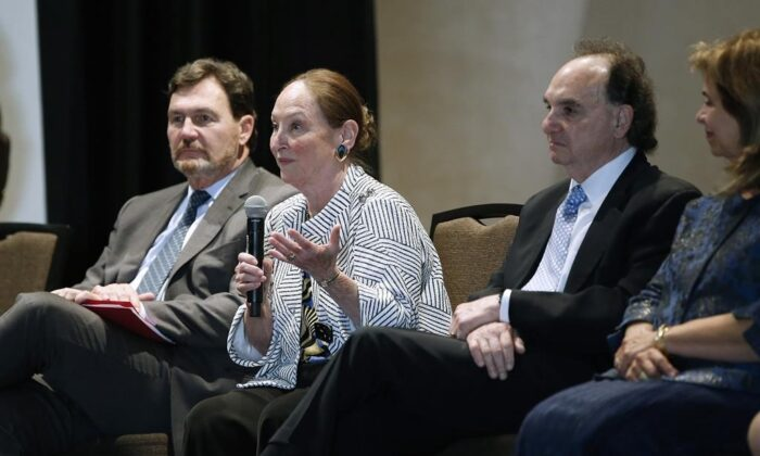 Supreme Court of Canada Chief Justice Richard Wagner, left, and fellow judges Michael Moldaver, second from right, and Andromache Karakatsanis, right, listen in as judge Rosalie Abella responds to a question during a question-and-answer session at Canadian Museum of Human Rights, in Winnipeg, on Sept. 25, 2019. Abella heard her last Supreme Court case Friday. (John Woods/The Canadian Press)