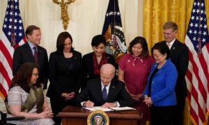 Biden Signs COVID-19 Hate Crimes Bill Into Law