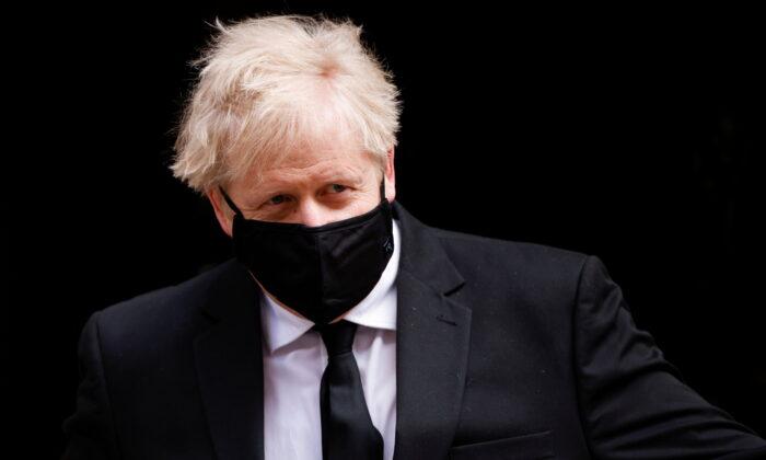 Britain's Prime Minister Boris Johnson walks outside Downing Street, amid the coronavirus disease (COVID-19) pandemic, in London, Britain, April 14, 2021. (John Sibley/Reuters)