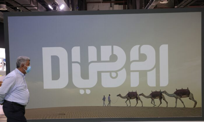 A visitor walks past a Dubai billboard at the Arabian Travel market exhibition in the Gulf emirate, on May 17, 2021. (Giuseppe Cacace/AFP via Getty Images)