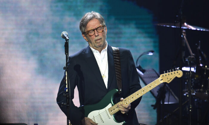 Eric Clapton performs on stage at The O2 Arena in London, England, on March 3, 2020. (Gareth Cattermole/Getty Images)