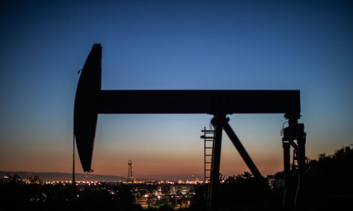 An oil pumpjack operates at dusk in Long Beach, Calif., on April 21, 2020. (Apu Gomes/AFP via Getty Images)