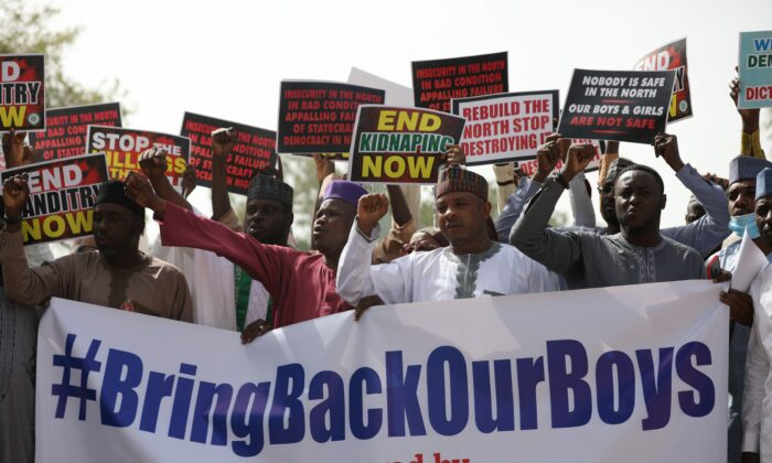 Supporters of the Coalition of Northern Groups (CNG) rally to urge authorities to rescue hundreds of schoolboys abducted by Boko Haram affiliated gangs, in northwestern state of Katsina, Nigeria on Dec. 17, 2020. (Kola Sulaimon/AFP via Getty Images)