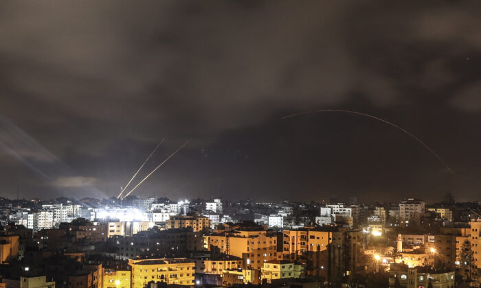 Rockets are fired from the Gaza Strip just before the start of the ceasefire brokered by Egypt between Israel and the ruling Islamist movement Hamas, in Gaza City on May 21, 2021. (Mahmud Hams/AFP via Getty Images)