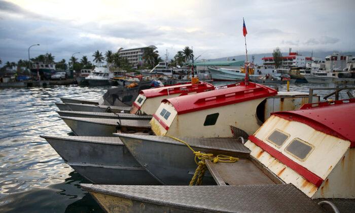 Fishing boats moored near the Apia Fish Market in Apia, Samoa on September 13, 2015. (Mark Kolbe/Getty Images)
