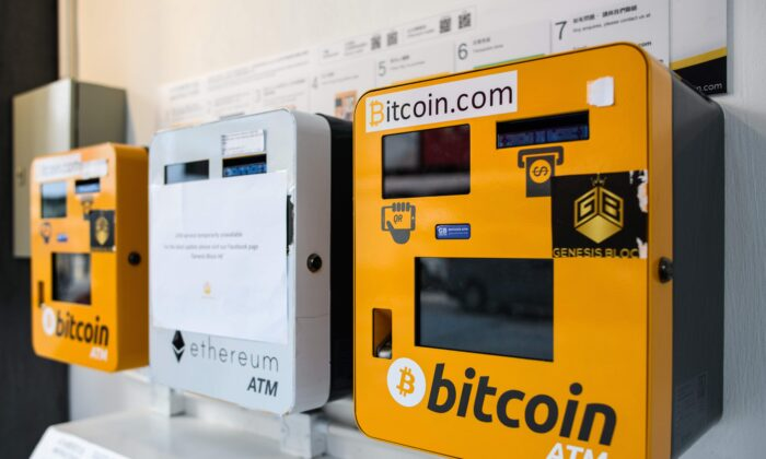 ATM machines (L and R) for the digital currency Bitcoin shown in Hong Kong, on December 18, 2017 are on the way out in China. (Photo by Anthony Wallace / AFP via Getty Images)
