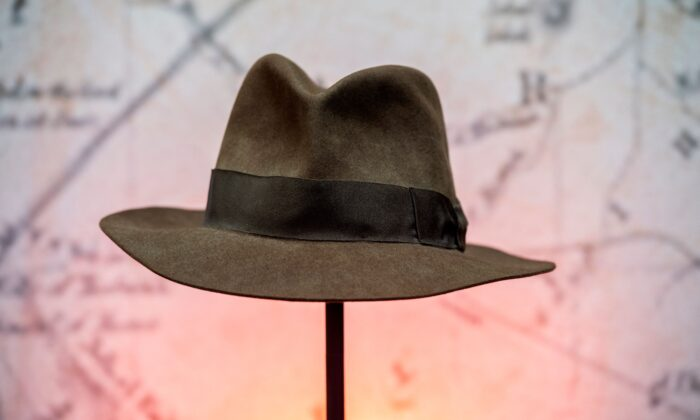 """Harrison Ford's Indiana Jones' fedora hat from the movie """"Indiana Jones & the Temple of Doom"""" is exhibited during a press preview of Prop Store's Iconic Film & TV Memorabilia in Valencia, Calif., on May 14, 2021. (Valerie Macon/AFP via Getty Images)"""