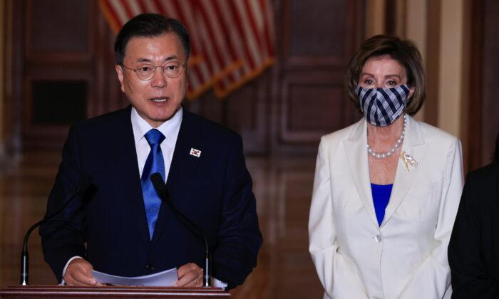 House Speaker Nancy Pelosi (D-Calif.) listens as South Korean President Moon Jae-in speaks during a meeting at the U.S. Capitol in Washington, on May 20, 2021. (Chip Somodevilla/Pool via Reuters)