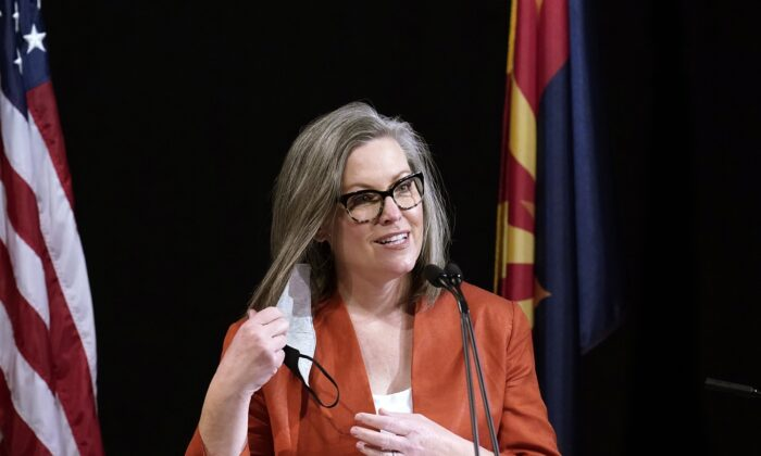 Arizona Secretary of State Katie Hobbs removes a mask as she speaks to members of Arizona's Electoral College prior to them casting their votes in Phoenix, Ariz., on Dec. 14, 2020. (Ross D. Franklin/File/AP Photo)