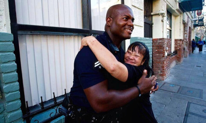 Officer Deon Joseph of the Los Angeles Police Department hugs a resident of Skid Row in downtown Los Angeles. (Courtesy of Deon Joseph)