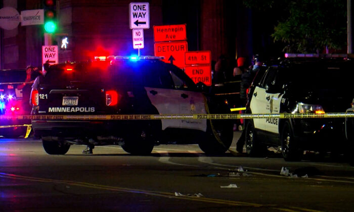 Police cars at a crime scene following a shooting in Minneapolis, Minn., early on May 22, 2021. (Courtesy of WCCO)