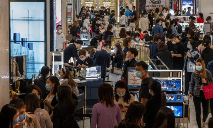Shoppers and staff in a cosmetic store at a mall in Beijing on April 18, 2021. (Kevin Frayer/Getty Images)