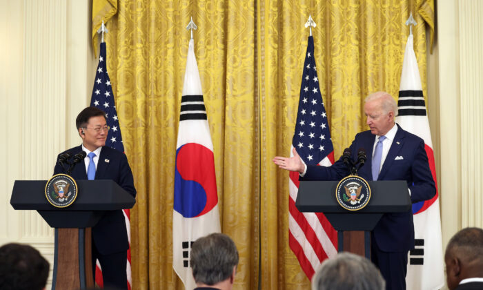 President Joe Biden (R) and South Korean President Moon Jae-in participate in a joint press conference in the East Room of the White House in Washington on May 21, 2021. (Anna Moneymaker/Getty Images)