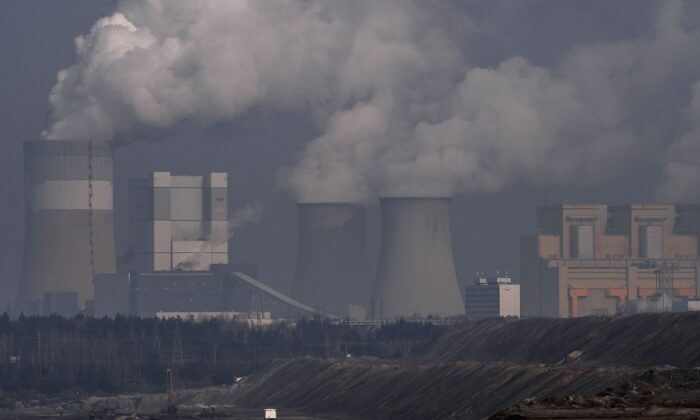 Steam and smoke rises from the Belchatow Power Station pictured from a viewing point over the open-pit coal mine in Rogowiec, Poland, on Feb. 23, 2021. (Omar Marques/Getty Images)