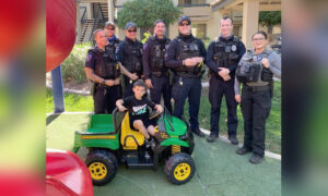 Police Officers Answer Family's Prayer, Gift Gator Tractor Toy to Boy After His Was Stolen
