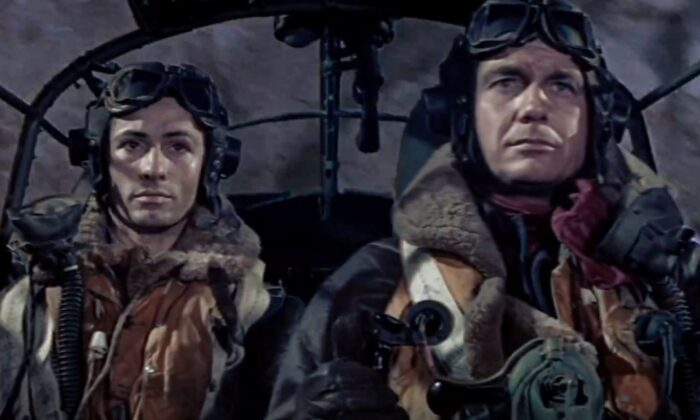 """Lt. Erik Bergman (George Chakiris, L) and Wing Commander Roy Grant (Cliff Robertson) take on a dangerous mission, in """"633 Squadron."""" (United Artists)"""