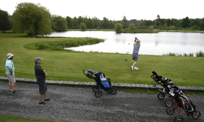A golfer tees off at Loch March Golf and Country Club in Ottawa on May 22, 2021, as golf courses and other outdoor recreation facilities reopen in Ontario. (The Canadian Press/Justin Tang)
