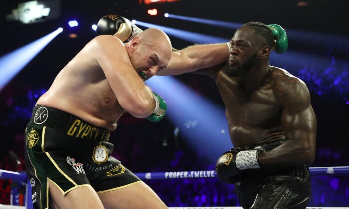 Deontay Wilder punches Tyson Fury during their Heavyweight bout for Wilder's WBC and Fury's lineal heavyweight title, at MGM Grand Garden Arena in Las Vegas, Nev., on Feb. 22, 2020. (Al Bello/Getty Images)