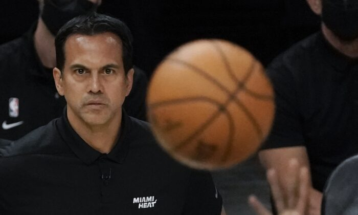 Miami Heat head coach Erik Spoelstra watches a shot during the first half of Game 1 of their NBA basketball first-round playoff series against the Milwaukee Bucks in Milwaukee, Wis., on May 22, 2021. (Morry Gash/AP Photo)