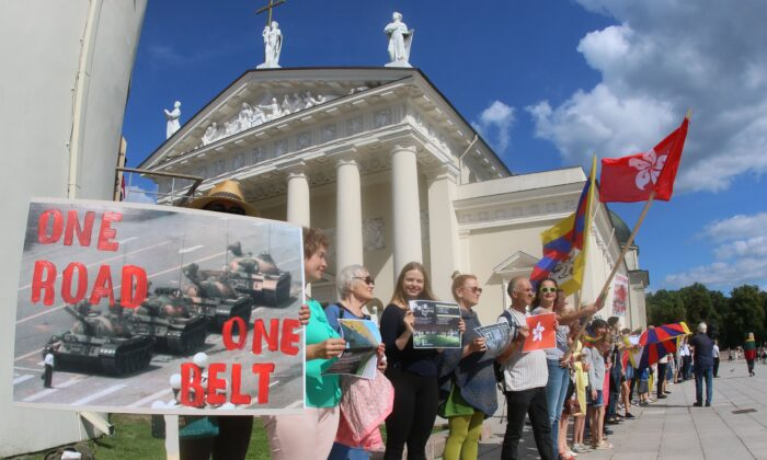 """People take part in a human chain protest in support of the Hong Kong Way, a recreation of a pro-democracy """"Baltic Way"""" protest against Soviet rule three decades ago, in Vilnius, Lithuania on Aug. 23, 2019. (Petras Malukas/AFP via Getty Images)"""