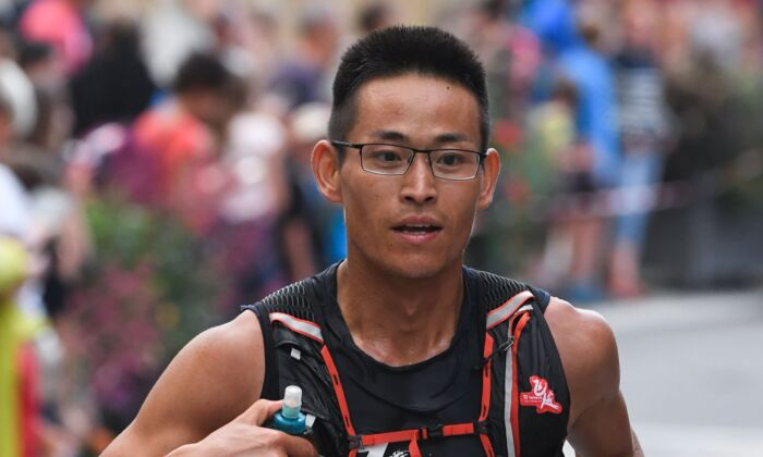 Chinese runner Jing Liang competes during the 170 kilometres Mont Blanc Ultra Trail (UTMB) race around Mont-Blanc, crossing France, Italy and Swiss, in Chamonix, France on Aug. 30, 2019. (Jean-Pierre Clatot/AFP via Getty Images)