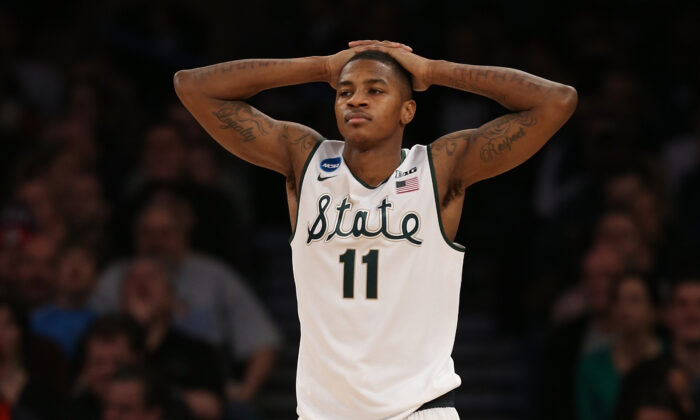 Keith Appling #11 of the Michigan State Spartans reacts against the Connecticut Huskies during the East Regional Final of the 2014 NCAA Men's Basketball Tournament at Madison Square Garden in New York City on March 30, 2014. (Bruce Bennett/Getty Images)