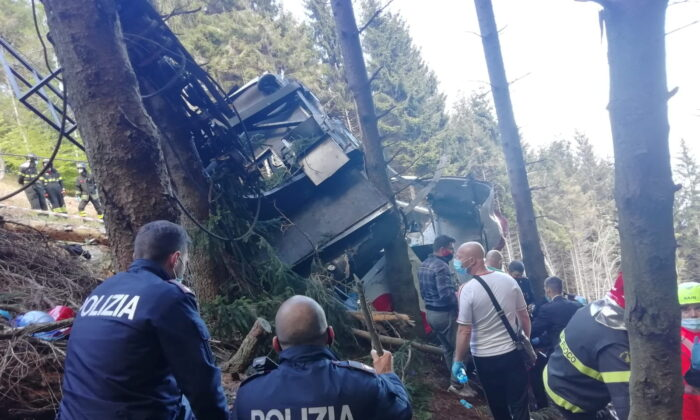 Police and rescue service members are seen near the crashed cable car after it collapsed in Stresa, near Lake Maggiore, Italy, on May 23, 2021. (Italian Police/Handout via Reuters)