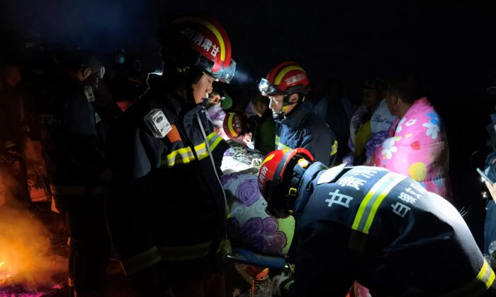 Rescuers assisting people who were competing in a 100-kilometer cross-country mountain race when extreme weather hit near the city of Baiyin in China's northwestern Gansu  Province, on May 22, 2021, leaving at least 20 dead. (AFP via Getty Images)