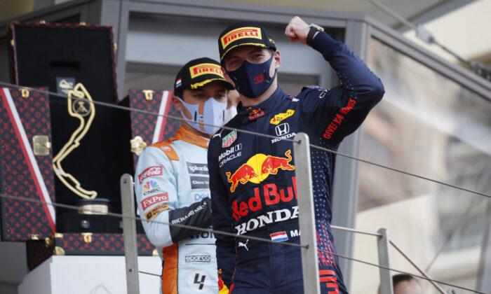 Red Bull driver Max Verstappen of the Netherlands celebrates after winning the Monaco Grand Prix at the Monaco racetrack, in Monaco, on May 23, 2021. (Sebastien Nogier/Pool via AP)