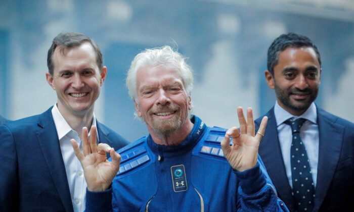 Virgin Galactic co-founder Sir Richard Branson, CEO George Whitesides and Social Capital CEO Chamath Palihapitiya pose together outside of the New York Stock Exchange in New York, on Oct. 28, 2019. (Brendan McDermid/Reuters)