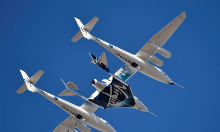 The Virgin Galactic rocket plane, the WhiteKnightTwo carrier airplane, with SpaceShipTwo passenger craft takes off from Mojave Air and Space Port in Mojave, Calif., on Feb. 22, 2019. (Gene Blevins/File Photo/Reuters)