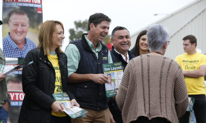 Dave Layzell for NSW Upper Hunter electorate greets voters alongside Deputy Premier John Barilaro (third from left) on polling day at the Muswellbrook Indoor Sports Centre in Muswellbrook, Australia on May 22, 2021. (AAP Image/Darren Pateman)