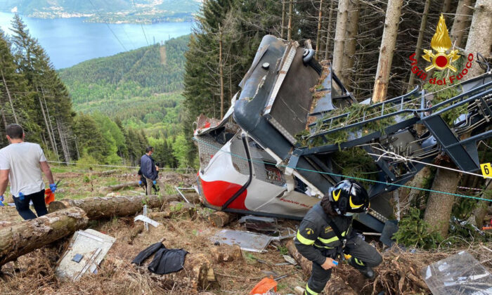 Rescuers work by the wreckage of a cable car after it collapsed near the summit of the Stresa-Mottarone line in the Piedmont region, northern Italy, on May 23, 2021. (Italian Vigili del Fuoco Firefighters via AP)