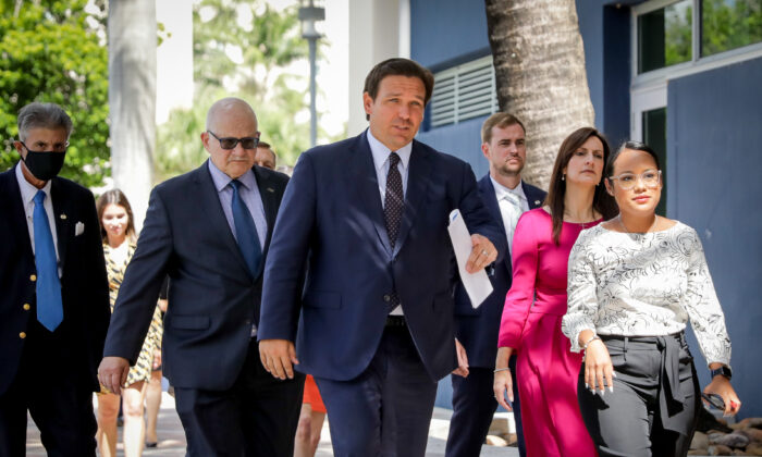 Florida Gov. Ron DeSantis arrives before signing into law Senate Bill 7072 at Florida International University in Miami on May 24, 2021. (Samira Bouaou/The Epoch Times)