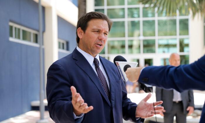 Florida Gov. Ron DeSantis departs after signing into law Senate Bill 7072 at Florida International University in Miami, Fla., on May 24, 2021. (Samira Bouaou/The Epoch Times)