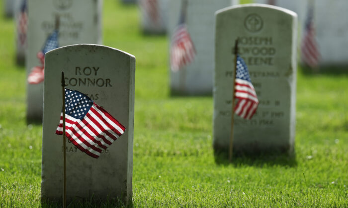 U.S. flags are placed in front of every grave site ahead of the Memorial Day weekend in Arlington National Cemetery in Arlington, Va., on May 21, 2020. (Chip Somodevilla/Getty Images)