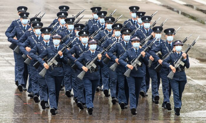 Police officers perform a new goose-stepping march, the same style used by police and troops on the Chinese mainland, at the city's police college during an open day to mark the National Security Education Day in Hong Kong on April 15, 2021. (ANTHONY WALLACE/AFP via Getty Images)