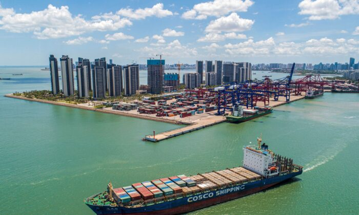 A cargo ship loaded with containers leaving a port in Haikou in China's southern Hainan province, on May 17, 2021. (STR/AFP via Getty Images)A cargo ship loaded with containers leaving a port in Haikou in China's southern Hainan province, on May 17, 2021. (STR/AFP via Getty Images)