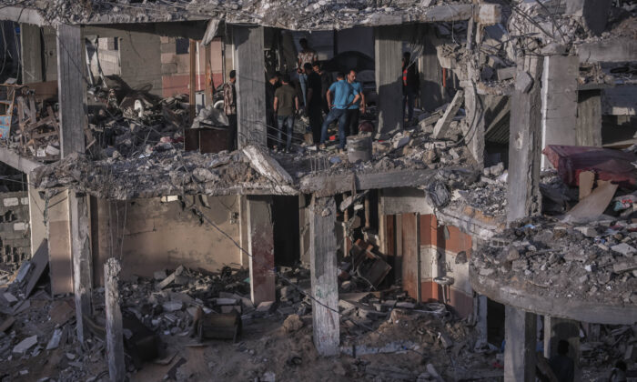 Palestinians inspect the rubble of their destroyed houses after a ceasefire between Israel and Gaza fighters, in Beit Hanun, northern Gaza Strip, Gaza City, on May 22, 2021. The ceasefire between Israel and Hamas appeared to be holding, despite fresh clashes at Al-Aqsa Mosque in East Jerusalem. (Fatima Shbair/Getty Images)