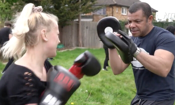 Harmonii Brown takes a boxing lesson from Leroy Nicholas in London on May 2, 2021. (Screenshot/NTD)